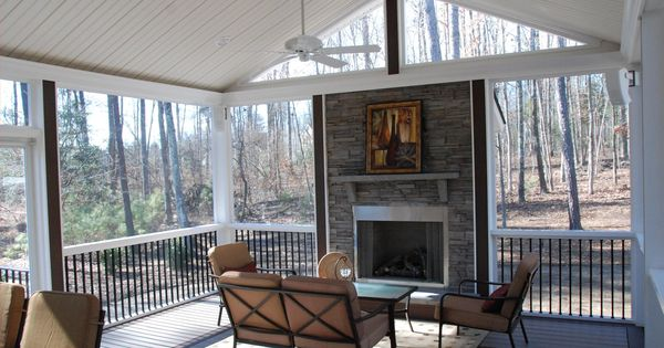 Rock Fireplace On A Screened In Porch Inspiring