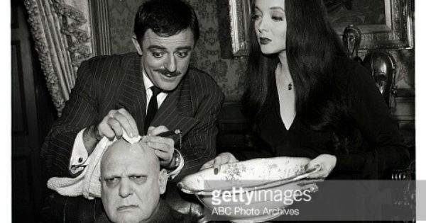 John astin as gomez carolyn jones as morticia and jackie for The addams family living room