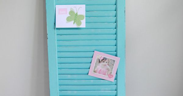Painted shutter....pretty way to display photos. You could paint it red or