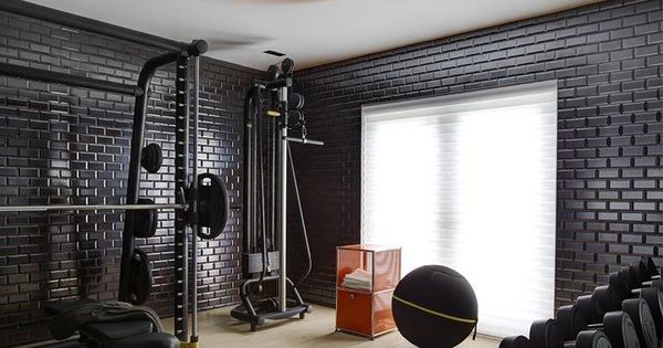 Inside an eclectic art deco miami home black brick wall