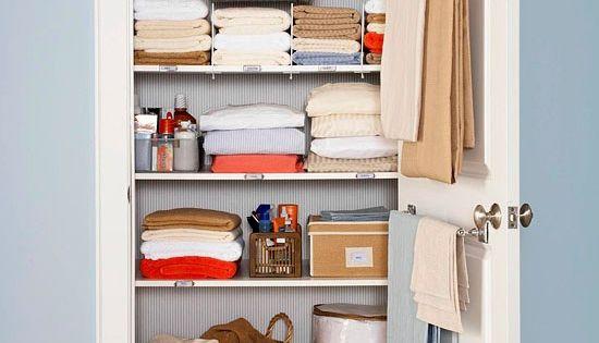 linen closet organization - great idea to put towel racks on the