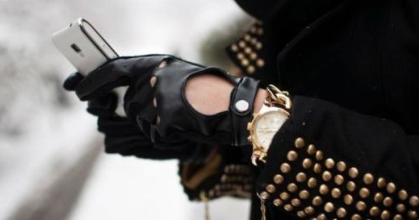 biker gloves and gold studded jacket