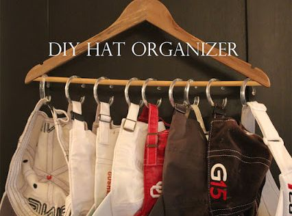 diy hat organizer; use old shower curtain rings on a hanger or