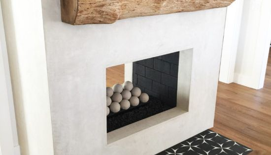 Foyer Decor St Sauveur : Rustic rough hewn mantel grey stucco fireplace with cement