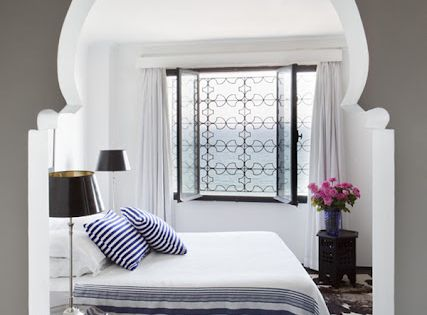 Airy Moroccan Bedroom - The Moroccan style archway accents this beautiful, airy