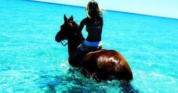 horseback riding in the ocean. this is going on the bucket list