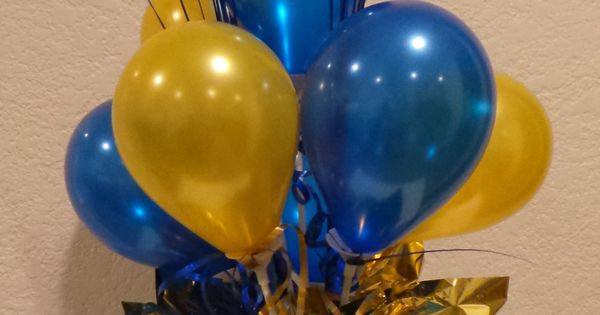 Blue and gold balloon centerpiece using quot balloons cub