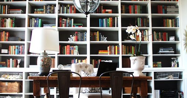 Love the idea of a combined library and dining room with wall