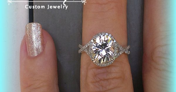 White Sapphire Engagement Ring 3.7ct Oval White Sapphire set in a 14k