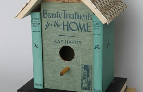 birdhouse made from old books. Tons of repurposed book ideas here...a book
