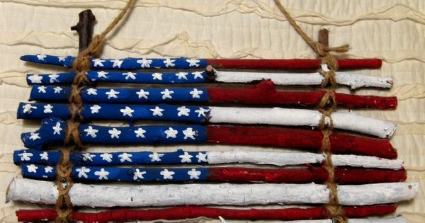 A flag made of sticks to hang on front door is a