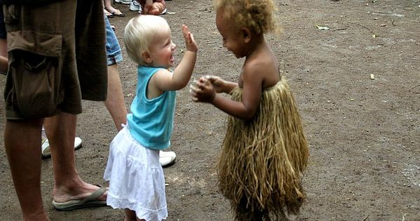 Great family travel memories from Vanuatu - happiness is meeting new friends.