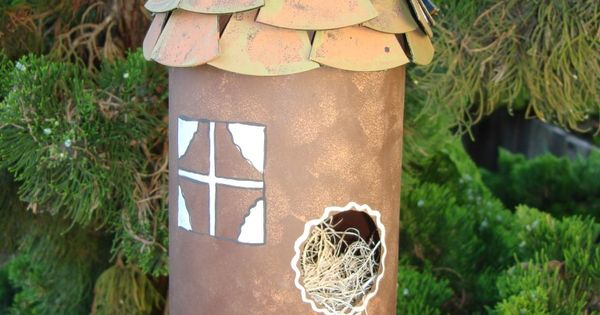 Recycled plastic bottle bird house make sure you poke for Plastic bottle bird house