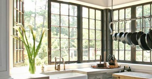 love the corner window, pot rack and cabinet color