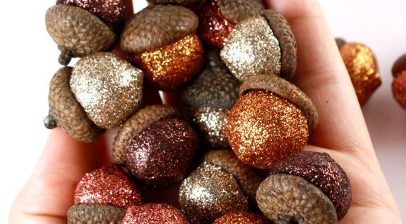 Apply glitter to the acorns then put them in a jar to