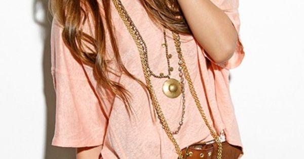 big pink shirt. brown belt. short white lace skirt.