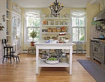 Farmhouse kitchen. I love the open shelving unit with the baskets and