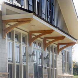Roof Overhang Supported By Stained Cedar Bracket Supports Modern Farmhouse Exterior Gable Roof Design Corbels Exterior