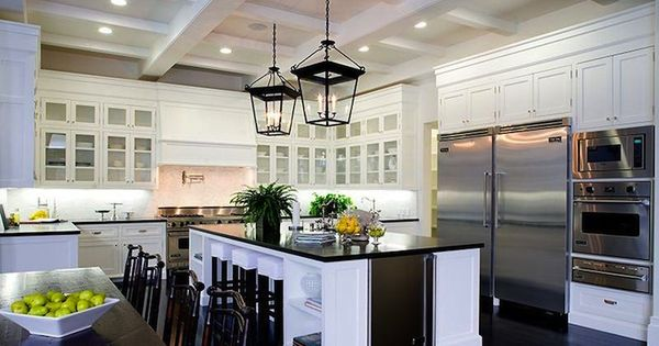 white kitchen cabinets dark island | Those light fixtures are amaze.