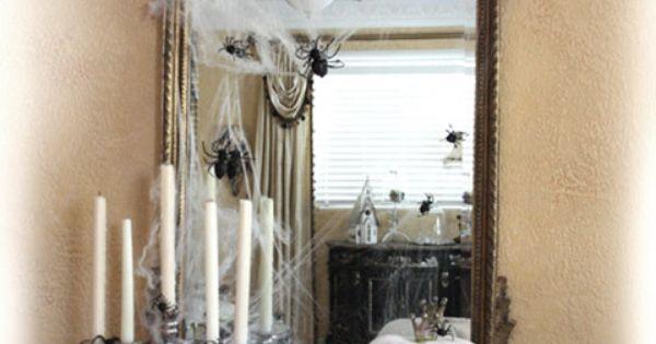 Halloween decor. Love the ornate mirror. White pumpkins, black accents, monograms &