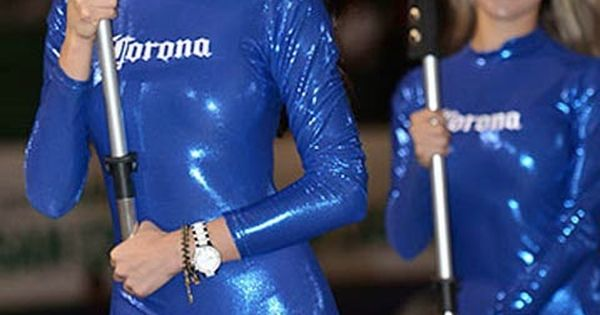 Women in shiny catsuits of a sponsoring team.
