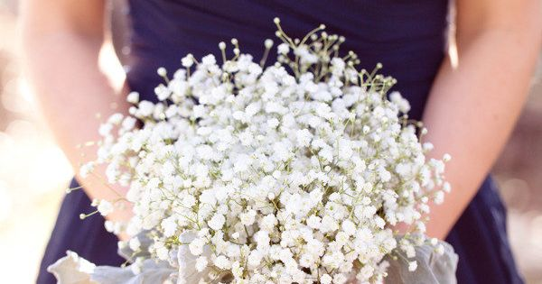 Baby's Breath as the Bridesmaid's bouquet. - Pretty navy and white color
