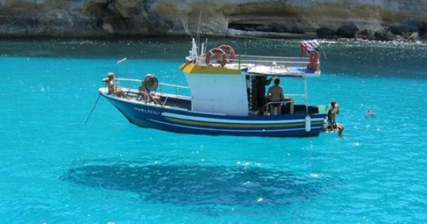 Pelagie Islands, Sicily. Crystal clear water makes it look like the boat