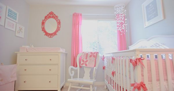 Such a sweet pink and grey room. Love the pink oval mirror