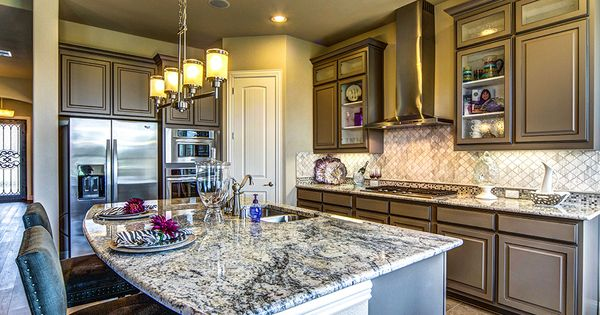 Brown cabinets glass cabinets and home kitchens on pinterest