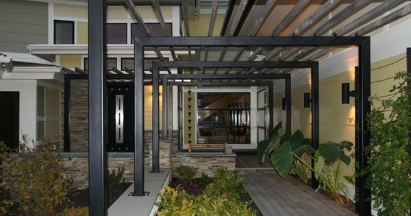 Modern metal pergola for the modern house innovative iron pergola design above the stone floor - Pergola climbing plants under natures roof ...
