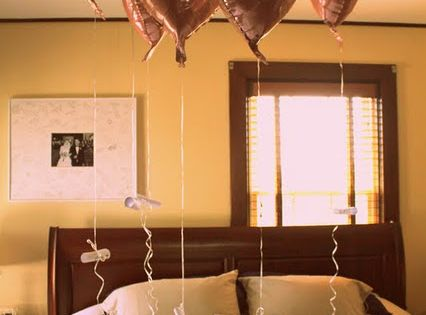 A balloon for each year married with a memory tied to it!