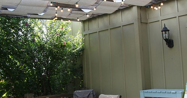 cheap paint tarps as the canvas to cover the pergola
