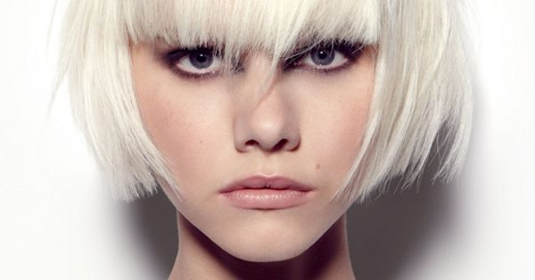 Blunt bangs on a platinum blonde bob