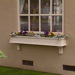 Long Beige Window Box On Stucco With Two Support Brackets Shutters Exterior Exterior Design Backyard Window Shutters Exterior