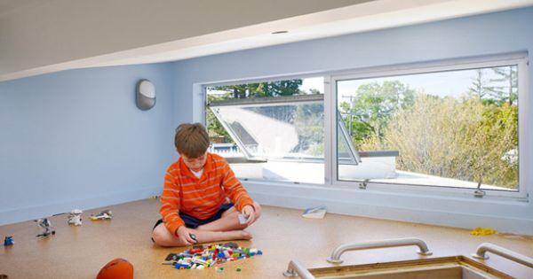 A loft playroom accessible from two children's bedrooms - this is so