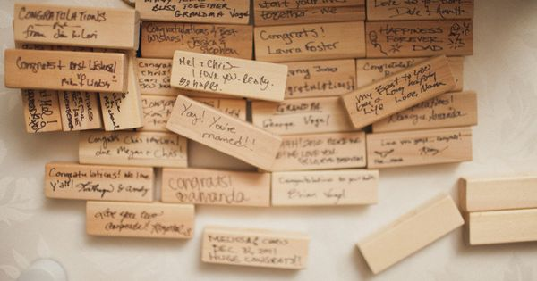 Guest book alternative ~ This bride used pieces of a Jenga game,