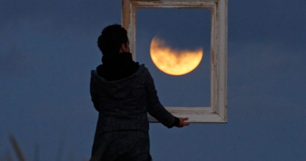 Catching the moon in a picture frame