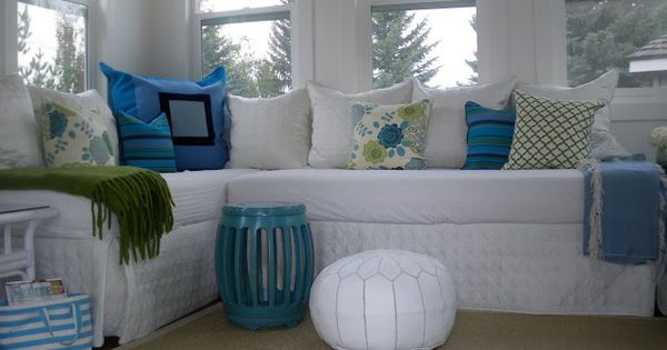 Two Twin Beds Put Together To Make Seating In An Outdoor