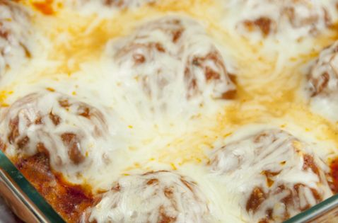 Baked Meatball Parmesan - Cheesy meatball parmesan with tomato sauce baked in