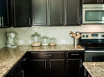 Arabesque Selene Tile Backsplash With Espresso Cabinets