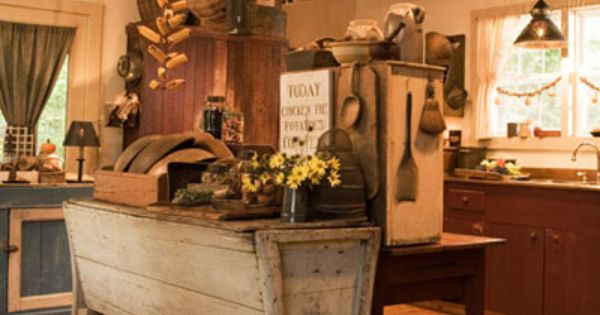 Primitive kitchen island and great collection of rustic kitchen implements.