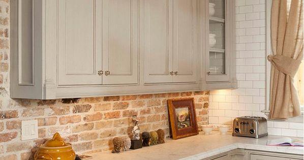 gray kitchen cabinet with brick backsplash whitestone builders