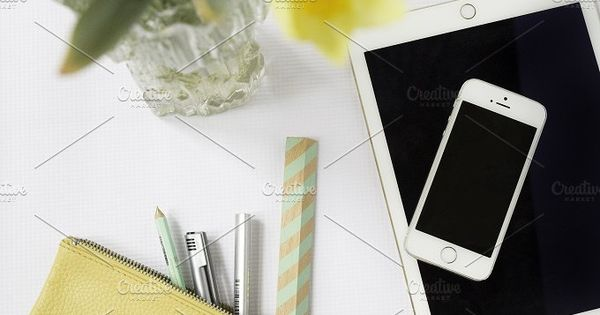 beautifully styled desktop featuring yellow leather pouch with pens and office supply accessories consisting of white white iPad