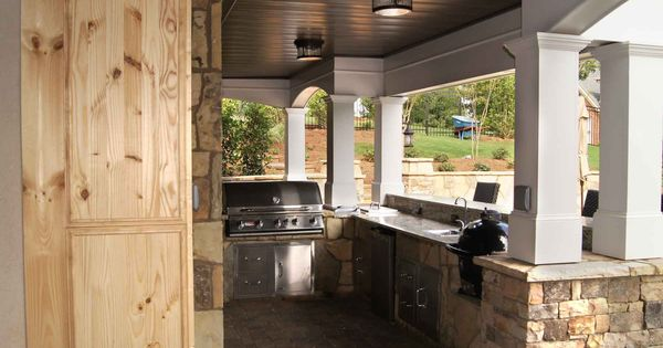 Outdoor kitchen under a small deck hover over the image for Outdoor kitchen under deck