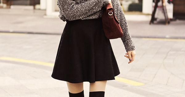 Marled sweater with black skater skirt + knee socks. Just looking for