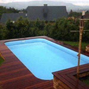 Above Ground Fiberglass Outdoor Swimming Pool Design With Wooden Deck Fiberglass Ou Above Ground Fiberglass Pools Inground Pool Landscaping Fiberglass Pools