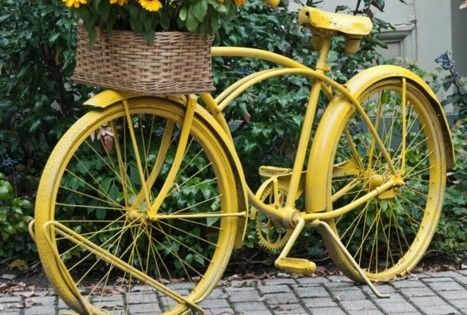 Yellow bike with yellow flowers. (1) From: Home Dit (2) Webpage has
