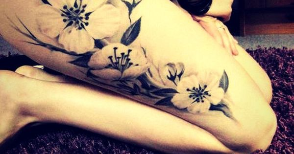 Black And White Flower Tattoo - use of negative space.