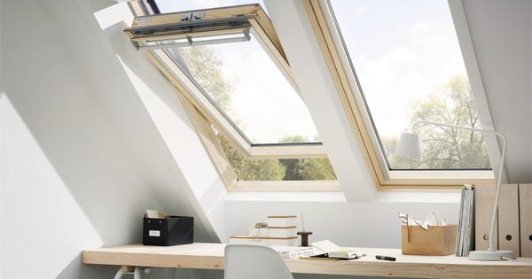 two center pivot velux roof windows placed side by side provide this upper story home office. Black Bedroom Furniture Sets. Home Design Ideas