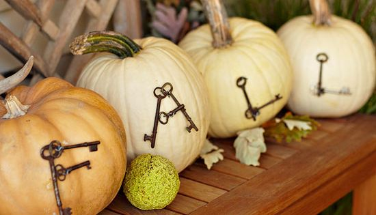 Use straight pins and antique keys to create a gorgeous fall display